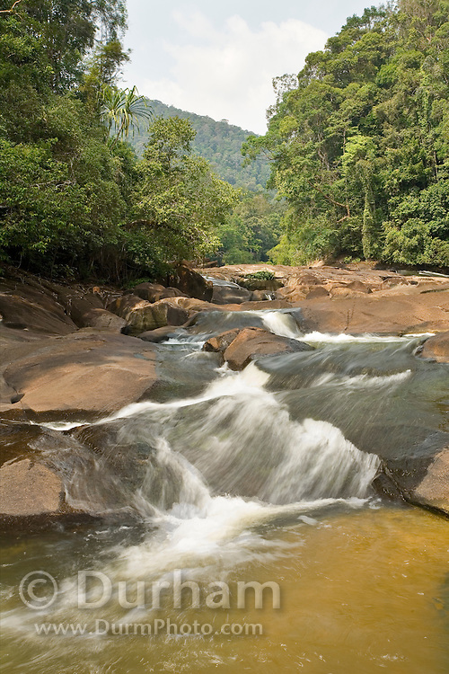 A small waterfall along the jasin River in Endau-Rompin National Park, Malaysia. This humid jungle is one of the world's oldest rainforest.  It has survived, untouched by the ice ages, for 130 million years.