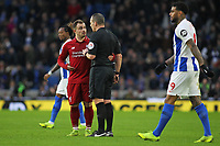 Football - 2018 / 2019 Premier League - Brighton and Hove Albion vs. Liverpool<br /> <br /> Xherdan Shaqiri of Liverpool tales to Referee Mr Kevin Friend after the half time whistle at The Amex Stadium Brighton <br /> <br /> COLORSPORT/SHAUN BOGGUST