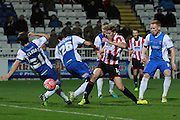 Michael Duckworth and Adam Jackson deflect a Asa Hall's shot during the The FA Cup match between Hartlepool United and Cheltenham Town at Victoria Park, Hartlepool, England on 7 November 2015. Photo by Antony Thompson.