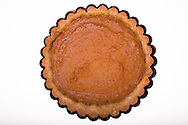 Want to add subtle flavor layers to your pumpkin tart?  Use cream for an extra flaky crust; and brush the cooled pastry with an almost imperceptable layer of warmed apricot preserves before pouring in the pumpkin filling.