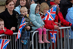 © Licensed to London News Pictures.  04/04/2012. OXFORD, UK. A crowd watches soldiers from 23 Pioneer Regiment march through the centre of Oxford. The troops have recently returned from Afghanistan are in Oxford due to redevelopment work and road closures in Bicester town centre, which prevents their regular homecoming ceremony from taking place. Photo credit :  Cliff Hide/LNP