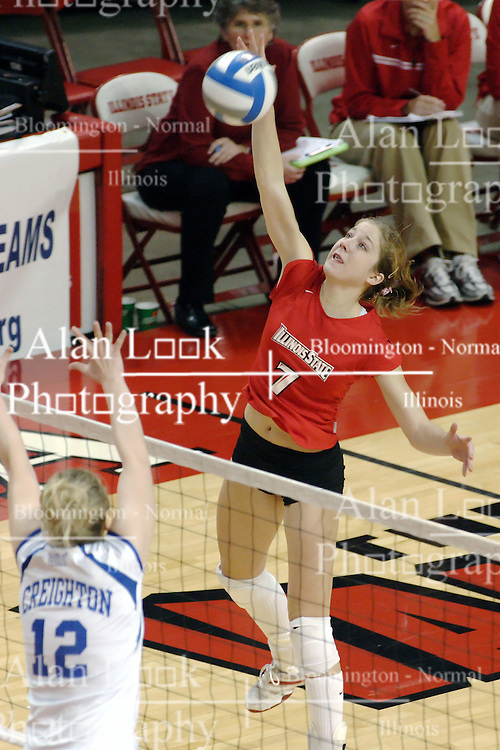 24 November 2006: Mary Catherine Richmond strikes the ball towards Kelly Goc during a Quarterfinal match between the Illinois State University Redbirds and the Creighton University Bluejays. The Tournament was held at Redbird Arena on the campus of Illinois State University in Normal Illinois.<br />