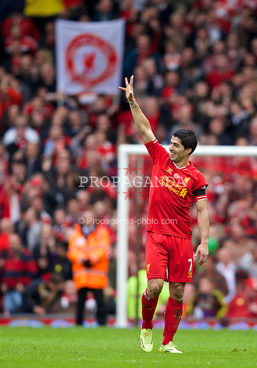 LIVERPOOL, ENGLAND - Sunday, April 13, 2014: Liverpool Luis Suarez celebrates his side's 3-2 victory over Manchester City during the Premiership match at Anfield. (Pic by David Rawcliffe/Propaganda)