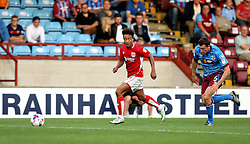 Bobby Reid of Bristol City runs with the ball past Murray Wallace of Scunthorpe United - Mandatory by-line: Robbie Stephenson/JMP - 23/08/2016 - FOOTBALL - Glanford Park - Scunthorpe, England - Scunthorpe United v Bristol City - EFL Cup second round
