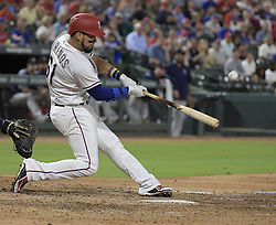 September 13, 2017 - Arlington, TX, USA - The Texas Rangers' Robinson Chirinos flies out to center field during the fourth inning against the Seattle Mariners at Globe Life Park in Arlington, Texas, on Wednesday, Sept. 13, 2017. (Credit Image: © Max Faulkner/TNS via ZUMA Wire)