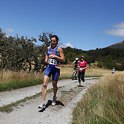 Janet Key in action during the run leg of the Paradise Triathlon and Duathlon series with breathtaking views of Mount Aspiring National Park, Paradise, Glenorchy, South Island, New Zealand. 18th February 2012. Photo Tim Clayton