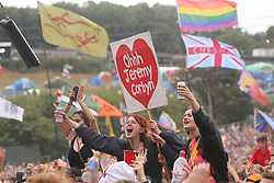 © Licensed to London News Pictures. 24/06/2017. Crowds with Jeremy COrbyn banners watch the Pyramid Stage at Glastonbury Festival. Photo credit: Jason Bryant/LNP