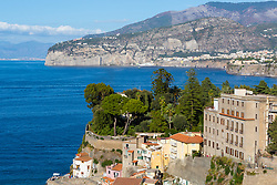 Sorrento, Italy, September 18 2017. Cedars, palms and conifers create a lush scene against the azure mediterranean sea in Sorrento, Italy. © Paul Davey