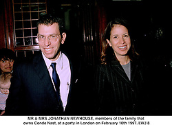 MR & MRS JONATHAN NEWHOUSE, members of the family that owns Conde Nast, at a party in London on February 10th 1997.LWJ 8