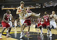 December 31 2012: Iowa Hawkeyes center Adam Woodbury (34) pulls down a rebound in front of Indiana Hoosiers forward Cody Zeller (40) during the first half of the NCAA basketball game between the Indiana Hoosiers and the Iowa Hawkeyes at Carver-Hawkeye Arena in Iowa City, Iowa on Monday December 31, 2012. Indiana defeated Iowa 69-65.