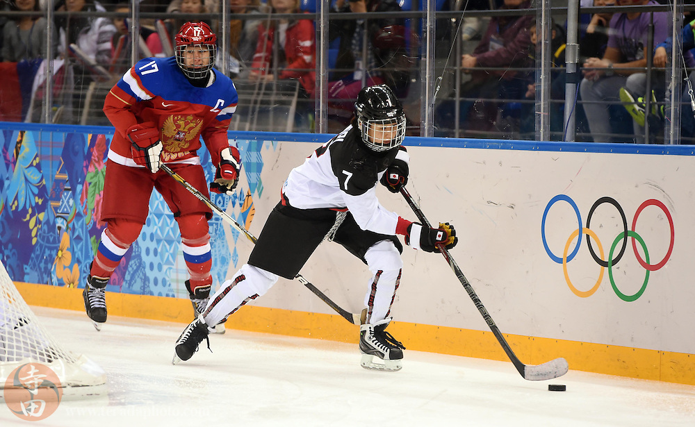 Feb 16, 2014; Sochi, RUSSIA; Japan defenseman Mika Hori (7) carries the puck away from Russia forward Yekaterina Smolentseva (17) in a women's ice hockey classifications round game during the Sochi 2014 Olympic Winter Games at Shayba Arena.