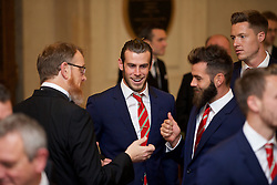 CARDIFF, WALES - Monday, October 5, 2015: Wales' head of international affairs Mark Evans, Gareth Bale and Joe Ledley during the FAW Awards Dinner at Cardiff City Hall. (Pic by David Rawcliffe/Propaganda)