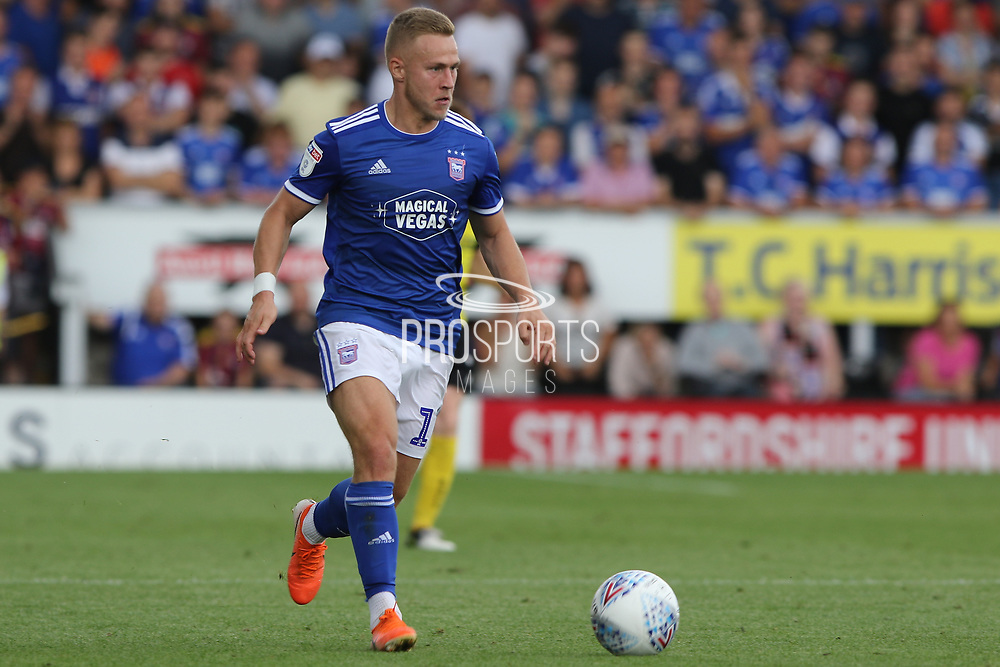 Ipswich Town midfielder Danny Rowe on the ball during the EFL Sky Bet League 1 match between Burton Albion and Ipswich Town at the Pirelli Stadium, Burton upon Trent, England on 3 August 2019.