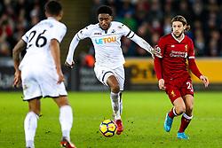 Leroy Fer of Swansea City is challenged by Adam Lallana of Liverpool - Rogan/JMP - 22/01/2018 - FOOTBALL - Liberty Stadium - Swansea, Wales - Swansea City v Liverpool - Premier League.