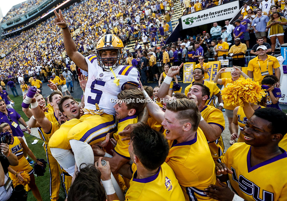 Oct 14, 2017; Baton Rouge, LA, USA; LSU Tigers running back Derrius Guice (5) is thrown into the air by LSU cheerleaders following a win against the Auburn Tigers in a game at Tiger Stadium. LSU defeated Auburn 27-23. Mandatory Credit: Derick E. Hingle-USA TODAY Sports