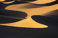 Picture of sand dunes with deep shadows in the Sahara desert of Morocco.
