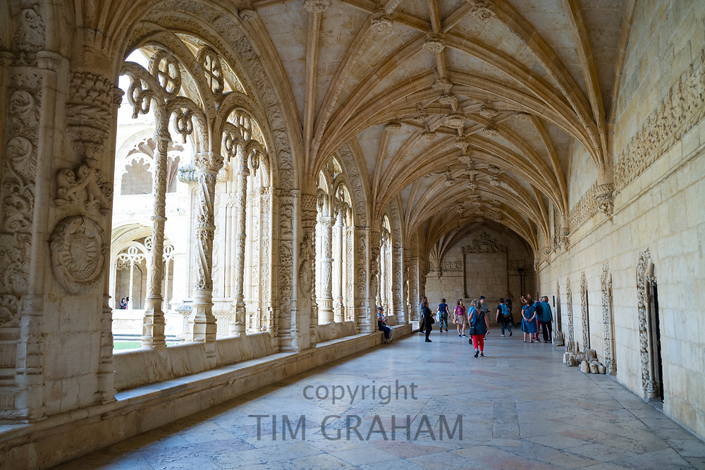Tourists in cloisters of famous Monastery of Jeronimos - Mosteiro  dos Jeronimos in Lisbon, Portugal
