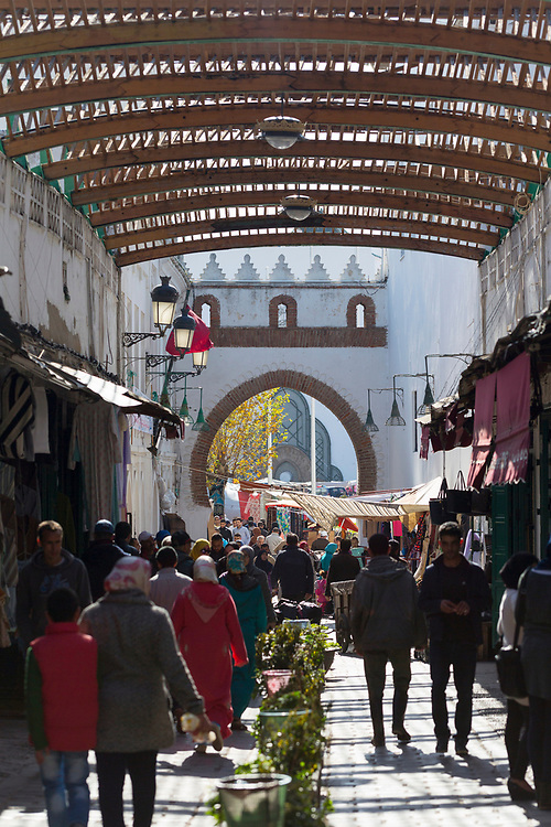 TETOUAN, MOROCCO - 6th April 2016 - People shopping under a covered area in the Tetouan Medina, Rif region of Northern Morocco.