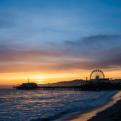 Santa Monica Pier California sunset vertical photo. Santa Monica a costal beach city in Southern California in the United States. Copyright ⓒ 2017 Paul Velgos with All Rights Reserved.