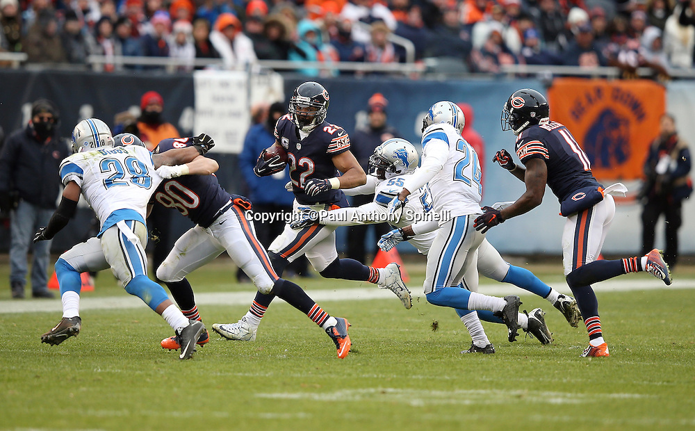 Chicago Bears running back Matt Forte (22) gets a block on Detroit Lions rookie cornerback Quandre Diggs (28) by Chicago Bears wide receiver Marc Mariani (80) as he tries to avoid a tackle attempt from behind by Detroit Lions middle linebacker Stephen Tulloch (55) as he runs for a first down at the two minute warning in the fourth quarter during the NFL week 17 regular season football game against the Detroit Lions on Sunday, Jan. 3, 2016 in Chicago. The Lions won the game 24-20. (©Paul Anthony Spinelli)