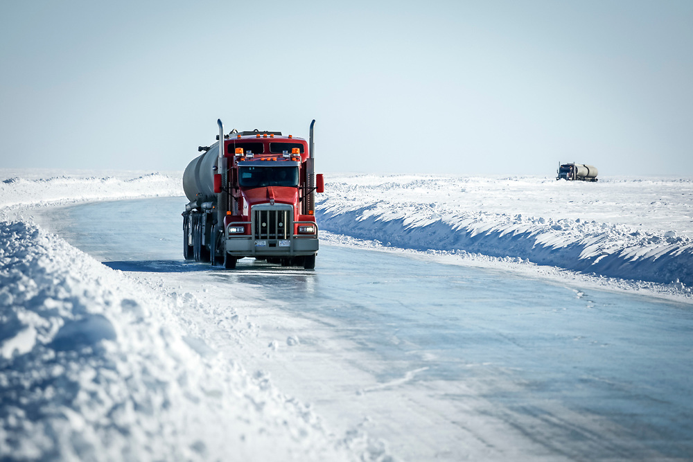 Fuel trucks drive on the Tuktoyaktuk ice road. With the completion on an all-season road, fuel and food in the community will be easier to transport in.