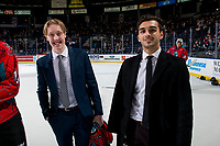 KELOWNA, CANADA - MARCH 16: Lassi Thompson #2 and Matt Barberis of the Kelowna Rockets line up for the shirt off your back presentation after the OT win against the Vancouver Giants on March 16, 2019 at Prospera Place in Kelowna, British Columbia, Canada.  (Photo by Marissa Baecker/Shoot the Breeze)