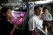 Israel Lopez and his family stand at the Quinta Crespo market in Caracas (Venezuela) Feb. 3, 2009 (Photo/Ivan Gonzalez)