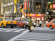 elderly woman caught in the middle of the road Shibuya Tokyo Japan