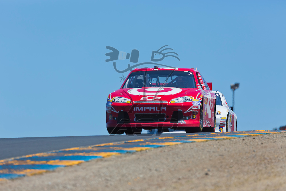 SONOMA, CA - JUN 24, 2012:  Juan Pablo Montoya (42) brings his car through the turns during the Toyota Save Mart 350 at the Raceway at Sonoma in Sonoma, CA.