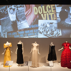 London, UK - 2 April 2014: Evening Dresses Biki 1971, Forquet 1966, Srelle Fontana 1960, Gattinoni 1955, Galtzine 1955 and Valentino 1977 during the press view of the 'The Glamour of Italian Fashion 1945-2014' exhibition at the Victoria & Albert Museum