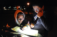 During Wednesday's early morning homeless census, guide Diana Soto and volunteer Javier Celedon pore over a map in Sherwood Park.