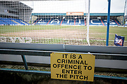 General view of the stadium with a criminal offence to enter the pitch sign during the EFL Sky Bet League 1 match between Oldham Athletic and Bury at Boundary Park, Oldham, England on 11 March 2017. Photo by Mark P Doherty.