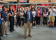 Walmart store manager Zain Mariscal talks with his team and Scarborough High School students, May 22, 2014.