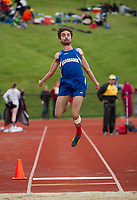 Gabe Carter of Kearsarge competes in the long jump during Sunday's Division III Track Championships at Interlakes High School.  (Karen Bobotas/for the Concord Monitor)