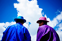 Two Mongolian men in colorful traditional garb at the traditional Naadam festival in Tsagaannuur, northern Mongolia.