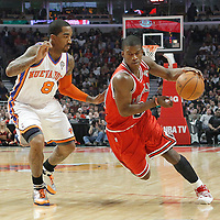 12 March 2012: Chicago Bulls guard Jimmy Butler (21) drives past New York Knicks shooting guard J.R. Smith (8) during the first half of New York Knicks vs Chicago Bulls, at the United Center, Chicago, Illinois, USA.