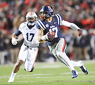 Ole Miss' tight end Evan Engram (17) heads upfield as Auburn Tigers' linebacker Kris Frost (17) chases at Vaught-Hemingway Stadium in Oxford, Miss. on Saturday, November 1, 2014. Auburn won 35-31.(AP Photo/Oxford Eagle, Bruce Newman)