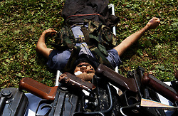 KUPWARA, KASHMIR - AUGUST 18: The body of a militant killed by Indian Army soldiers along the Line of Control in the Keran Sector of the Kupwara District in the Indian held state of Jammu and  Kashmir is displayed for media August 18, 2002.  Indian Army troops killed 7 militants early yesterday morning as they attempted to infiltrate from Pakistan along the Line of Control. They carried with them a large quantity of ammunition, arms and jehadi literature.   (Photo by Ami Vitale/Getty Images)