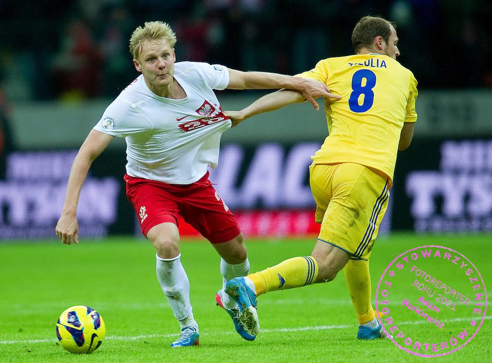 (L) Daniel Lukasik of Poland fights for the ball with (R) Roman Zozula of Ukraine during the 2014 World Cup Qualifying Group H soccer match between Poland and Ukraine at National Stadium in Warsaw on March 22, 2013...Poland, Warsaw, March 22, 2013...Picture also available in RAW (NEF) or TIFF format on special request...For editorial use only. Any commercial or promotional use requires permission...Photo by © Adam Nurkiewicz / Mediasport