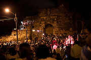 Dominican Republic:  Every Sunday evening, under open skies, against the backdrop of Las Ruinas del Monasterio de San Francisco, the sounds of Merengue, Salsa, Son and Bachata fill a Caribbean air. .In the historical Zona Colonial, Grupo Bonyé - a group of some 16 musicians, reminiscent of Cubas own Buena Vista Social Club, belt out Latin American and Caribbean melodies for free. Performing purely for pleasure..Neighbours, strangers, tourists, young and old Dominicans will tell you they learn to dance before they can walk!..Dance, talk, listen, drink, dance repeat. ..Space on the wooden, tiny dance floor is at a premium. But if you can stand on it, then you can dance on it. No barging, bumping. A little grinding bringing always a smile. ..play on!