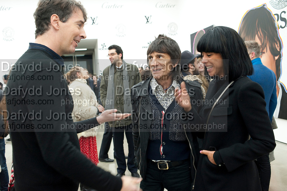 RICHARD PHILLIPS; RONNIE WOOD; ANNA ARAUJO, Richard Phillips, Most Wanted. Private view at White Cube. Hoxton Sq. London. 27 January 2011, -DO NOT ARCHIVE-© Copyright Photograph by Dafydd Jones. 248 Clapham Rd. London SW9 0PZ. Tel 0207 820 0771. www.dafjones.com.
