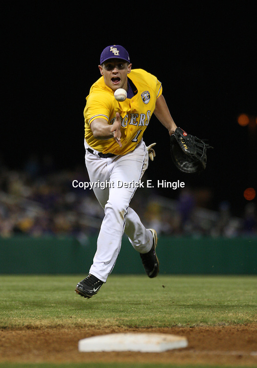 2009 February 20: LSU first baseman Sean Ochinko tosses the ball during a NCAA baseball match up between the #1 ranked LSU Tiger and the unranked Villanova Wilcats at the newly constructed Alex Box Stadium in Baton Rouge, Louisiana..
