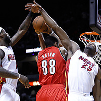 08 March 2011: Portland Trail Blazers small forward Nicolas Batum (88) goes to the basket past Miami Heat small forward LeBron James (6) and Miami Heat center Erick Dampier (25) during the Portland Trail Blazers 105-96 victory over the Miami Heat at the AmericanAirlines Arena, Miami, Florida, USA.
