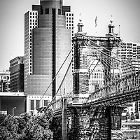 Cincinnati John A. Roebling bridge black and white picture with the Scripps Center building in downtown Cincinnati Ohio. Photo Copyright © 2012 Paul Velgos with All Rights Reserved.