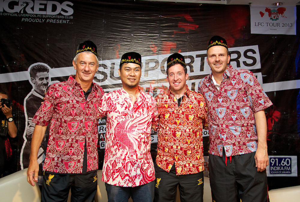JAKARTA, INDONESIA - Thursday, July 18, 2013: Liverpool ambassadors Ian Rush, Robbie Fowler and Dietmar Hamann pose with designer Iyan Rahadian in Batik-style Indonesian shirts at a fans' event at the FX Senayan Centre ahead of Liverpool FC's visit to Indonesia as part of their Preseason Tour. (Pic by David Rawcliffe/Propaganda)