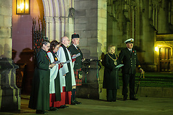 © Licensed to London News Pictures. 11/11/2018. Manchester, UK. A service of remembrance for those killed in war , is held at 6am outside Manchester Cathedral , on the morning of the 100th anniversary of Armistice Day , marking the end of the First World War . Photo credit: Joel Goodman/LNP
