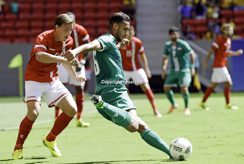 04.08.2016. Brasilia, Brazil. Ali Adnan of Iraq and Nielsen Casper Denmark during the match between Iraq (IRQ) versus Denmark (DEN), the first game of Football Group A Olympic mens tournament held at the Mané Garrincha Stadium, Brasilia.