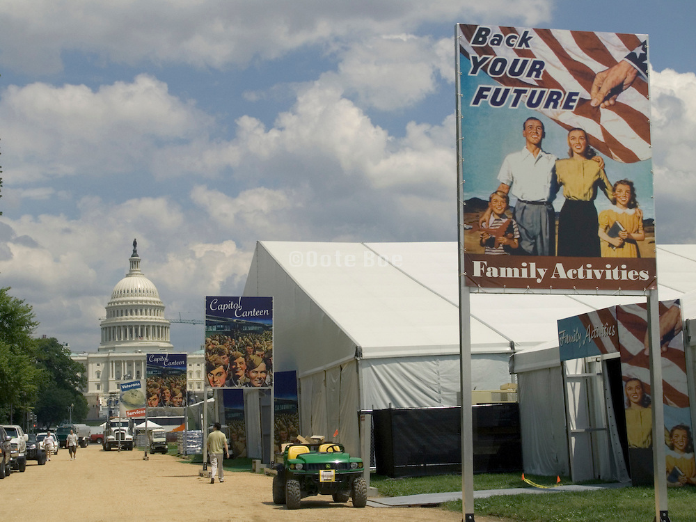A 1940s poster at the National WW 2 reunion Washington DC May 27-30 2004 with US Capitol building in the background