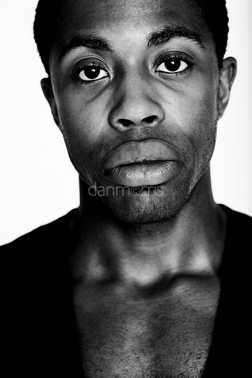 Portrait of young African American man with white backdrop