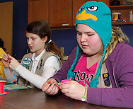 Girl Scouts work on a craft project during Program Aide (PA) training at the Girl Scouts urban campus in Dayton, Saturday, March 3, 2012.